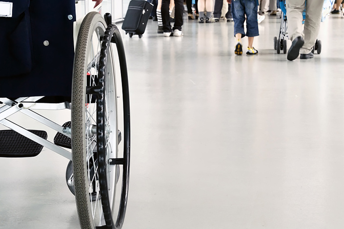 A close-up view of a wheelchair in an airport hall